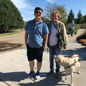 Client with volunteer and guide dog